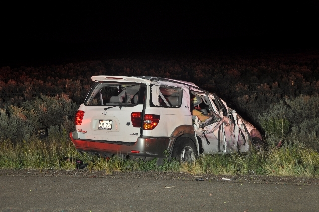 This Tuesday, July 30 photo released by New Mexico State Police shows a car wreck that happened Monday evening on U.S. 550 near Cuba, about 85 miles north of Albuquerque, N.M. Texas A&M said Tuesd ...