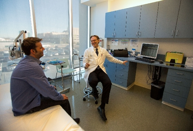 Dr. Timothy West, right, talks with MS patient Jason Buckley at the Cleveland Clinic Lou Ruvo Center for Brain Health in January. The center announced an expansion of the MS staff that will allow  ...