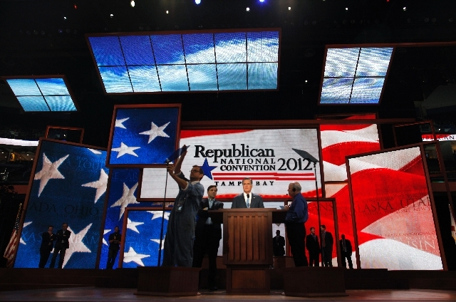 Republican presidential nominee Mitt Romney looks over the placement of the teleprompter during a sound check at the Republican National Convention in Tampa, Fla., on Aug. 30, 2012.