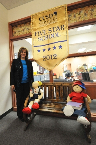 Wright Elementary School was designated as one of the few high-achieving, five-star schools in the Clark County School District. Principal Carol Erbach shows her school's award in the hallway Nov. ...