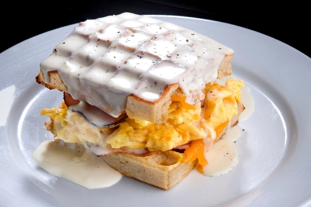 A waffle sandwich is one of the menu items at Bread & Butter restaurant.