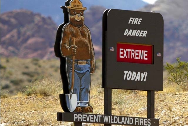 A sign warns of fire danger. Smokey Bear may be an icon of fire policies that need an update.
