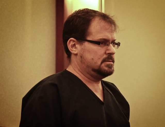 Former Clark County prosecutor David Schubert, shown here in court on Nov. 7, 2012, was found dead on July 17 in his home. The Clark County coroner has ruled his death a suicide.