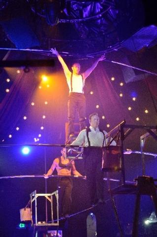 "Almas Meirmanov, left, Tony Hernandez, center, and Paul Matthew Lopez perform as the Esteemed Gentlemen of the High Wire during ""Absinthe."""