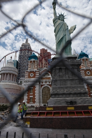 Construction crews inspect work at the memorial for 9/11 at the New York New York hotel and casino in Las Vegas Friday, July 26.