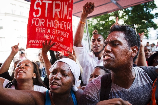 Demonstrators supporting fast food workers protest outside a McDonald's as they demand higher wages and the right to form a union without retaliation July 29 in New York's Union Square.
