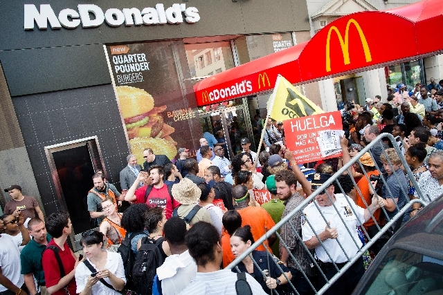 Demonstrators in support of fast food workers protest outside a McDonald's as they demand higher wages and the right to form a union without retaliation July 29 in New York's Union Square.