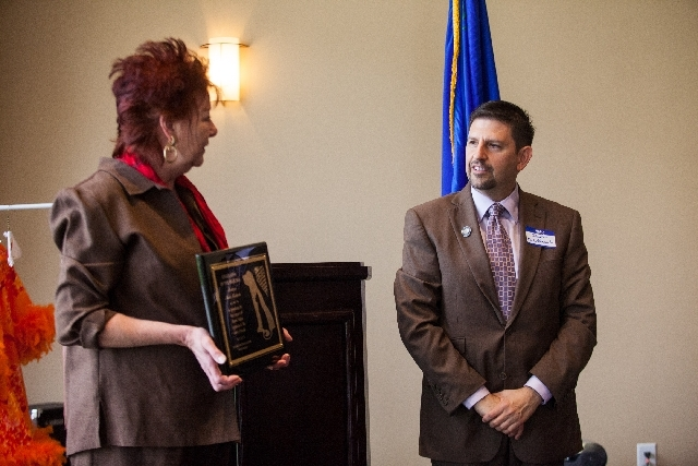 """Nevada Political Actions for Animals President Stacia Newman, left, presents the """"Legislator of the Year Award"""" to Nevada State Sen. Mark Manendo during a Las Vegas luncheon last month."""