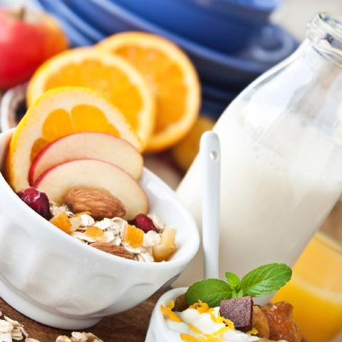 Scientists have found eating breakfast helps cut cholesterol and boosts weight loss.