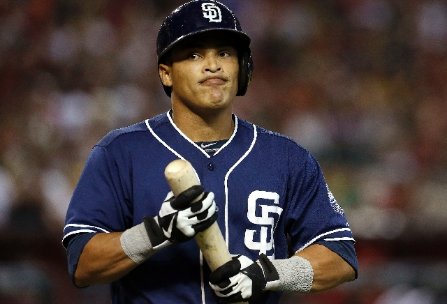 In this July 28, 2013 file photo, San Diego Padres' Everth Cabrera strikes out looking in the eighth inning of a baseball game against the Arizona Diamondbacks on  in Phoenix. Major League Basebal ...