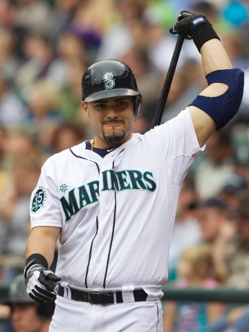 In this Sept. 9, 2012 photo, Seattle Mariners' Jesus Montero warms up before an at-bat during a baseball game against the Oakland Athletics at Safeco Field in Seattle. Major League Baseball has to ...