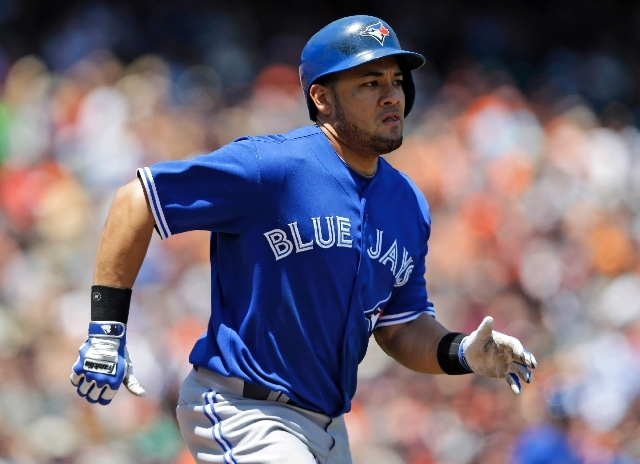 In this June 5, 2013 file photo, Toronto Blue Jays' Melky Cabrera runs to first base as he grounds out during the fifth inning of a baseball game against the San Francisco Giants in San Francisco.