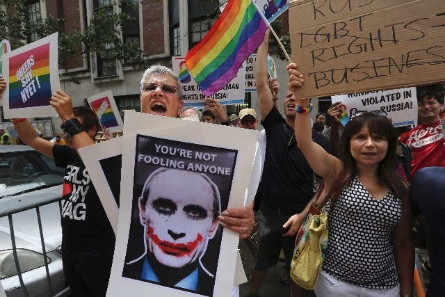 Gay rights activist Cathy Marino-Thomas, center, of Brooklyn, chants slogans during a demonstration in front of the Russian consulate in New York on July 31. Russia will enforce a new law cracking ...