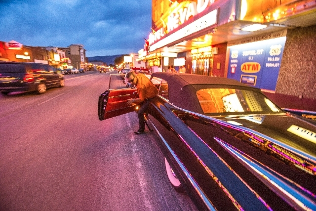 Jostein Henden from Norway gets out of his 1959 Cadillac Series 62 convertible on July 23 in front of the Hotel Nevada in Ely. The city was one of the stops on the Lincoln Highway centennial tour  ...
