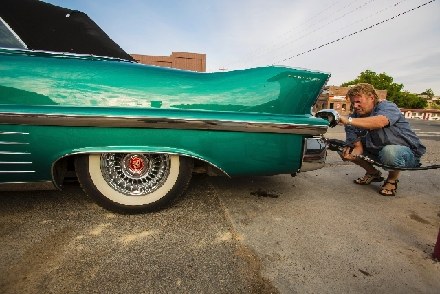 Arild Kolnes of Norway fuels up his 1958 Cadillac in Eureka on July 23 during the Lincoln Highway Association centennial tour. A caravan of 80 classic vehicles included a '48 Chevy Fleetline, two  ...