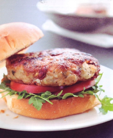 """The recipe for chicken and sun-dried tomato burgers is in """"6 Ingredient Solution: How to Coax More Flavor from Few Ingredients"""" by America's Test Kitchen."""