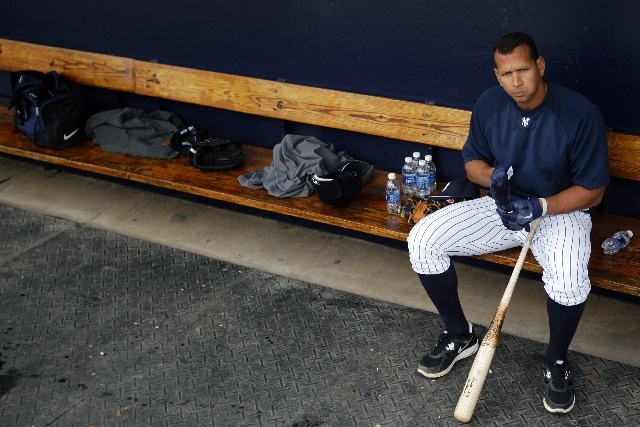 In this Feb. 25, 2012, file photo, New York Yankees' Alex Rodriguez sits in the dugout during practice at baseball spring training in Tampa, Fla.  Baseball is threatening to kick Rodriguez out of  ...