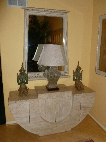 The console table sets the scale for the lamp and accessories in this setting.