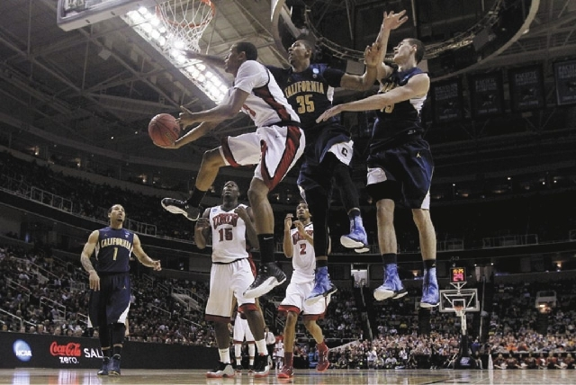 UNLV guard Bryce Dejean-Jones, third from right, shoots against California forwards Richard Solomon (35) and David Kravish during the first half of a second-round game in the NCAA tournament in Sa ...