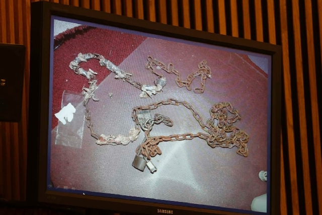 Chains found in an upstairs bedroom at the Seymour Ave. house are shown on a television monitor during the sentencing phase of Ariel Castro Thursday in Cleveland. Three months after an Ohio woman  ...