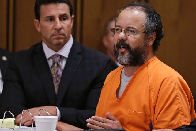Ariel Castro, right, speaks during the sentencing phase as defense attorney Craig Weintraub watches Thursday in Cleveland. Castro was sentenced to life in prison plus 1,000 years.