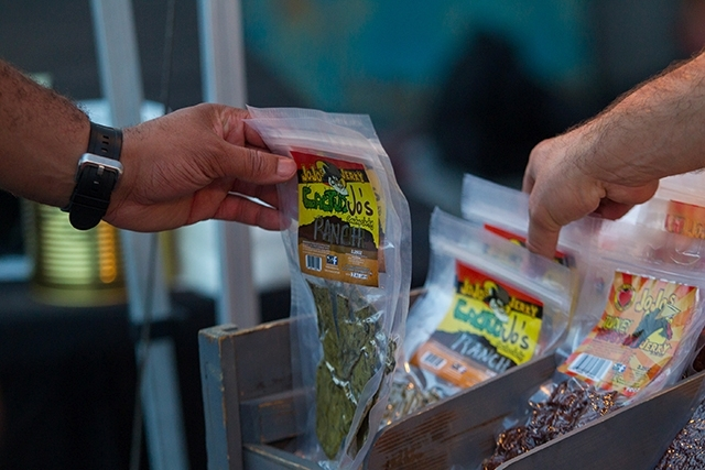 Customers browse through jerky during the car show July 26.