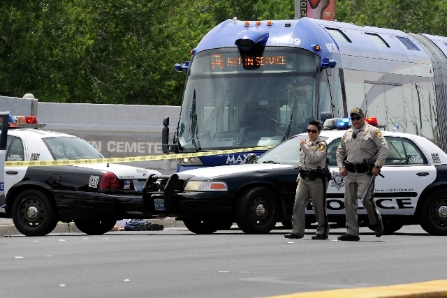 Las Vegas Metro officers investigate an incident involving a Citizens Area Transit bus and a pedestrian along Las Vegas Boulevard just south of Owens on Friday.  The man was killed during the noon ...