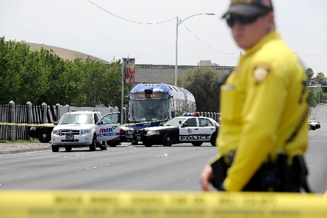 A Las Vegas Metro officer secures the scene of an incident involving a Citizens Area Transit bus and a pedestrian along Las Vegas Boulevard just south of Owens on Friday. The man has been identified.