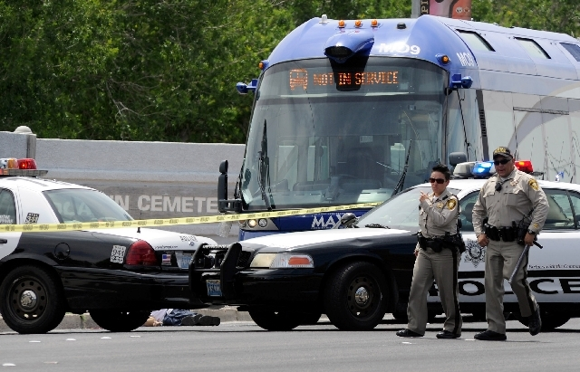 Las Vegas Metro officers investigate an incident involving a Citizens Area Transit bus and a pedestrian along Las Vegas Boulevard just south of Owens on Friday.