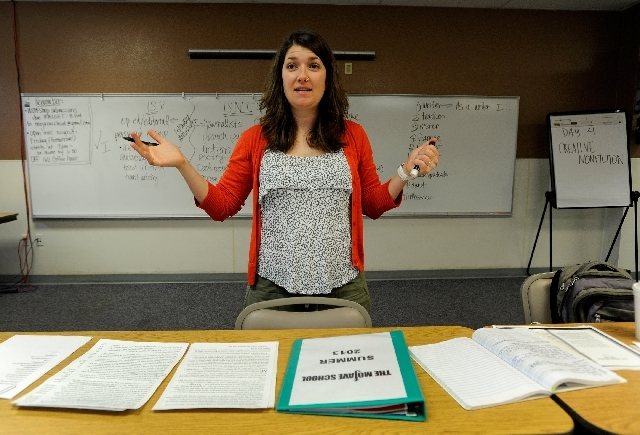 """Author and teacher Claire Vaye Watkins works with her creative writing class Thursday at the Mojave School in Pahrump . Author of """"Battleborn,"""" a critically acclaimed book of short stories, Watkin ..."""