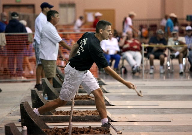 Alan Francis of Defiance, Ohio, competes during the qualifying round of the National Horseshoe Pitchers Association World Tournament on Wednesday at St. George, Utah. Francis went on to capture hi ...