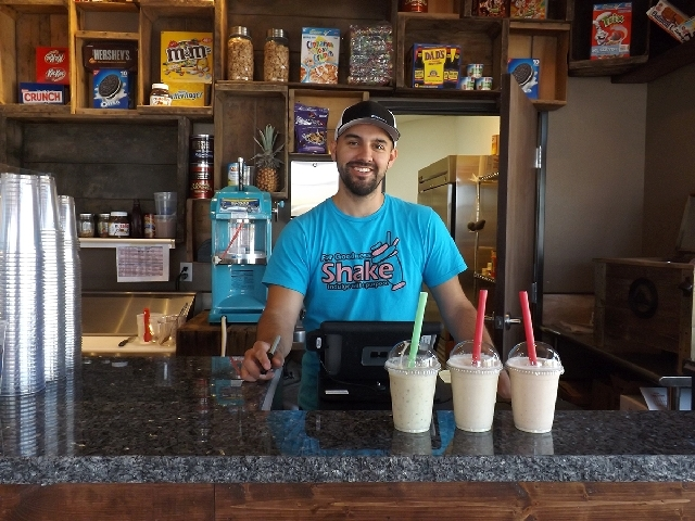 Manny Vargas, owner and head community shaker, displays milkshakes at For Goodness Shake, 4220 S. Grand Canyon Drive, No. 8, July 29. Vargas said he wants to give back to the community by donating ...