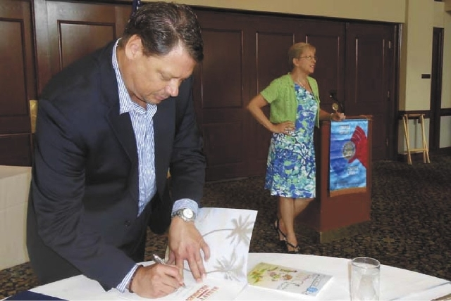 Pat Skorkowsky, new Clark County School District superintendent, signs books for the Rotary Club of Las Vegas Summerlin on July 23 at TPC Summerlin, where he outlined his vision for the district.