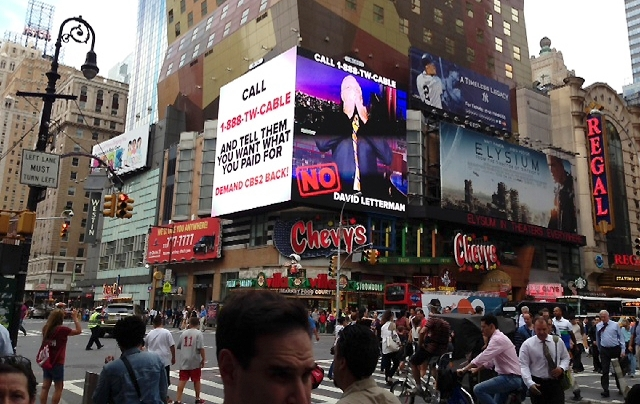 This image provided by CBS shows a CBS advertisement in Times Square in New York on Friday.