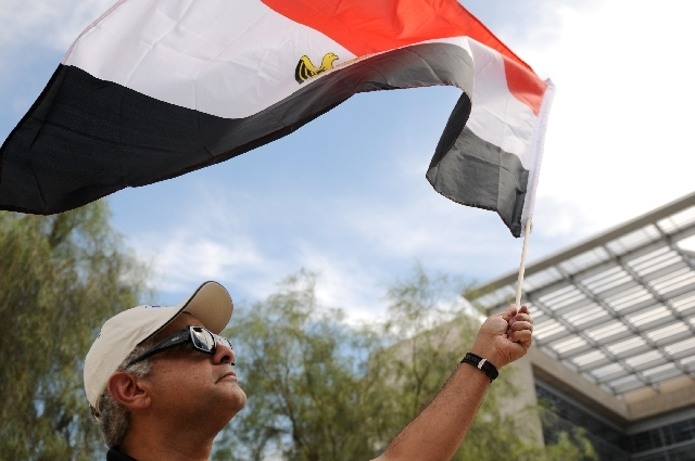 Aziz Tiger, waves an Egyptian flag during a rally in support of President Mohamed Morsi outside of the the Lloyd D. George Federal Courthouse.