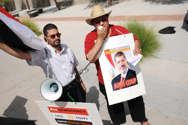 From left, Ahmad Fayed, and Mohammed Maybed, rally outside of the the Lloyd D. George Federal Courthouse in support of the Egyptian elected President Mohamed Morsi.