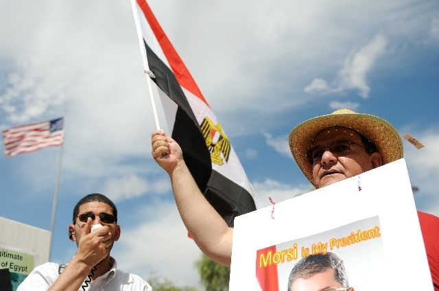From left, Ahmad Fayed, and Mohammed Maybed, rally outside of the the Lloyd D. George Federal Courthouse in support of the Egyptian elected President Mohamed Morsi, Saturday in Las Vegas.