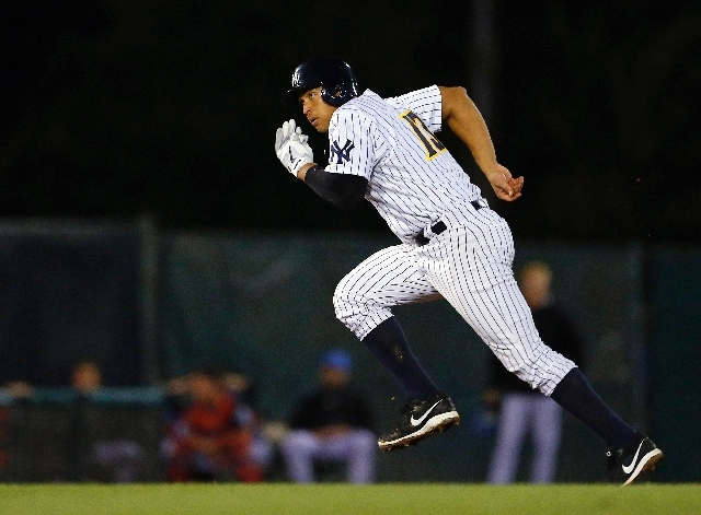 New York Yankees' Alex Rodriguez (13) advances to third base on a single by Jose Pirela during the seventh inning of a minor league baseball rehab start with the Trenton Thunder in a game against  ...