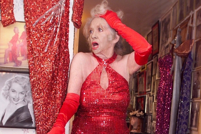 Burlesque icon Dixie Evans, who launched the Exotic World museum in Helendale California, has died at age 86, according to the Burlesque Hall of Fame. Evans is seen in 2003 in Helendale, Calif.