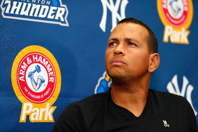 New York Yankees third baseman Alex Rodriguez answers questions from the media during a press conference after a minor league baseball rehab start with the Trenton Thunder in a game against the Re ...
