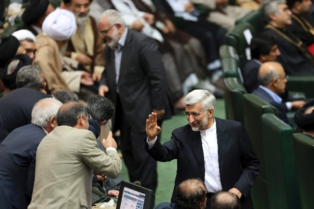 Iran's top nuclear negotiator, Saeed Jalili, who was a candidate of the June 14 presidential election, waves as he attends the swearing-in ceremony of the new President, Hasan Rouhani, at the parl ...