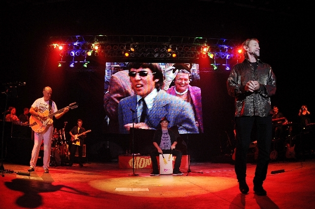 Here they come, yes, it's quite a feat. The Monkees, from left Michael Nesmith, Micky Dolenz and Peter Tork perform July 27 in Boca Raton, Fla. An image of Davy Jones, the Monkee who died in 2012  ...