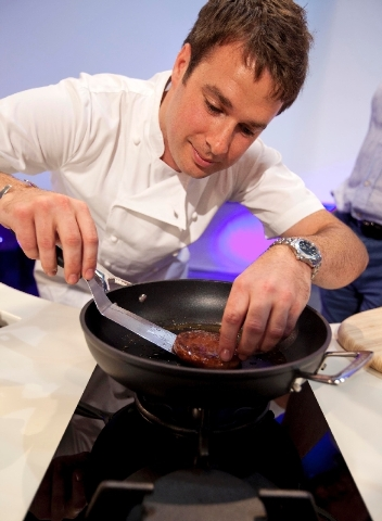 A new burger made from cultured beef grown in a laboratory from stem cells of cattle is cooked by chef Richard McGeown during the world's first public tasting event for the food product held in Lo ...
