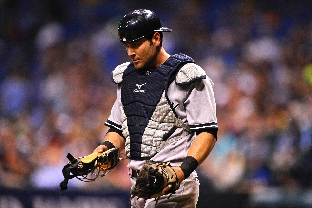 In this April 24, 2013 file photo, New York Yankees catcher Francisco Cervelli  reacts during the fourth inning of a baseball game against the Tampa Bay Rays in St. Petersburg, Fla. Major League B ...