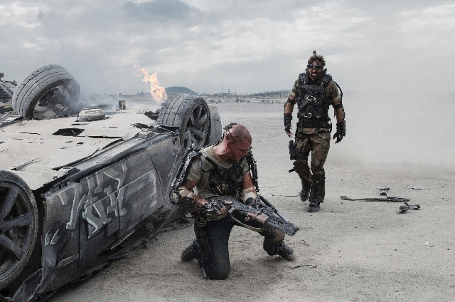 "This film publicity image released by TriStar, Columbia Pictures-Sony shows Matt Damon, left, and Sharlto Copley in a scene from ""Elysium."""