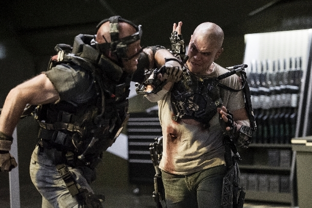 "This film publicity image released by TriStar, Columbia Pictures-Sony shows Matt Damon, right, in a scene from ""Elysium."""