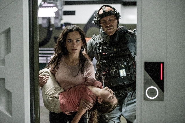 "This film publicity image released by Tristar, Columbia Pictures-Sony shows Alice Braga, left, Emma Tremblay and Josh Blacker, right,  in a scene from ""Elysium."""