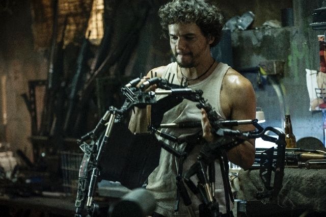 "This film publicity image released by TriStar, Columbia Pictures-Sony shows Wagner Moura in a scene from ""Elysium."""