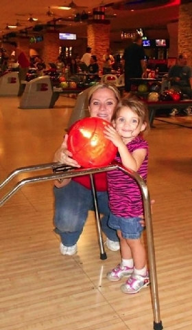 Team Ford Lincoln title clerk Melanie Cox and her daughter Kaelin Cox take part in Bowling for Babies at Santa Fe Station Bowling Center.
