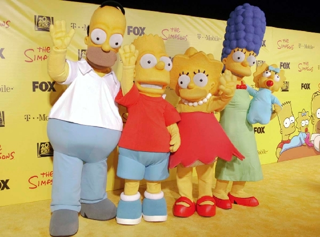 Homer, Bart, Lisa, Marge and Maggie Simpson arrive at The Simpsons Treehouse of Horror XX & 20th Anniversary Party in the Barker Hangar in Santa Monica, Calif., in this 2009 file photo. Danish toy ...